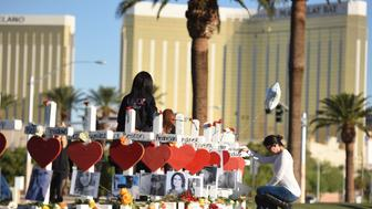 58 white crosses for the victims of Sunday night's mass shooting o the Las Vegas Strip just south of the Mandalay Bay hotel, October 6, 2017 in Las Vegas, Nevada. On October 1, 2017 Stephen Paddock killed at least 58 people and injured more than 450 after he opened fire on a large crowd at the Route 91 Harvest country music festival. The massacre is one of the deadliest mass shooting events in US history. / AFP PHOTO / Robyn Beck        (Photo credit should read ROBYN BECK/AFP/Getty Images)