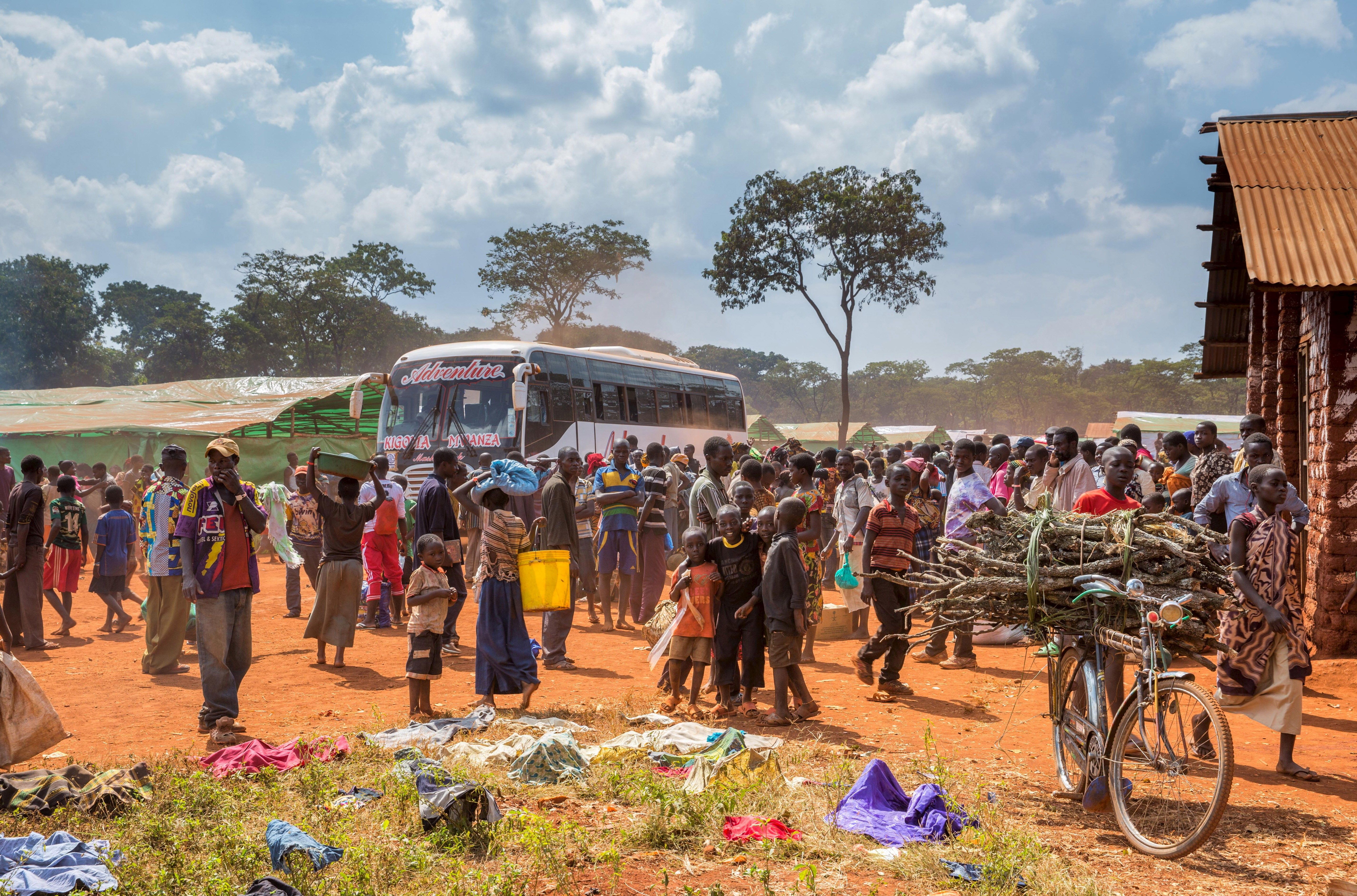 Refugees from Burundi who fled the ongoing violence and political tension arrive at the Nyarugusu refugee camp in western Tanzania in this May 28, 2015 handout photo by PLAN INTERNATIONAL. East African leaders will meet on Sunday to discuss the crisis in Burundi as violent clashes between police and anti-government protesters continue and the opposition has boycotted talks to resolve the stand-off. Picture taken May 28, 2015. REUTERS/Sala Lewis/PLAN INTERNATIONAL/Handout via Reuters   ATTENTION EDITORS - THIS PICTURE WAS PROVIDED BY A THIRD PARTY. REUTERS IS UNABLE TO INDEPENDENTLY VERIFY THE AUTHENTICITY, CONTENT, LOCATION OR DATE OF THIS IMAGE. FOR EDITORIAL USE ONLY. NOT FOR SALE FOR MARKETING OR ADVERTISING CAMPAIGNS.