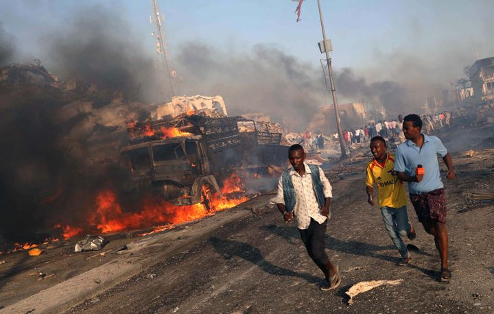 Civilians evacuate from the scene of an explosion in KM4 street in the Hodan district of Mogadishu, Somalia October 14, 2017.