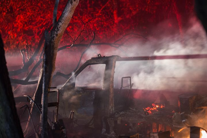 A truck and property burns in the early morning hours on October 14, 2017 in Sonoma, California.