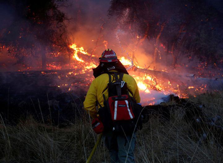 Firefighters battle a wildfire near Santa Rosa, California, U.S., October 14, 2017. (REUTERS/Jim Urquhart)