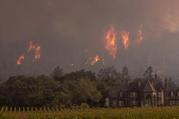 Flames rise behind Ledson Winery on October 14, 2017 in Kenwood, near Santa Rosa, California. (Photo by David McNew/Getty Ima