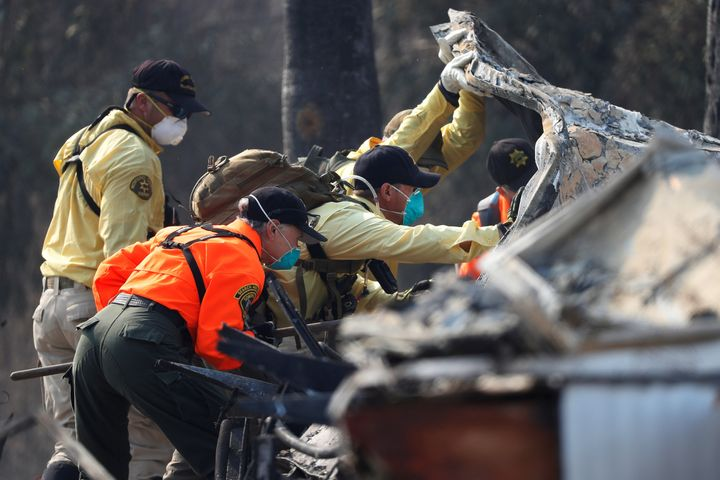 Search and Rescue teams search for two missing people amongst ruins at Journey's End Mobile Home Park destroyed by the Tubbs