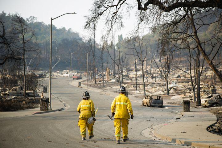 Firefighters walk through the Fountaingrove neighborhood on October 13, 2017 in Santa Rosa, California. (Photo by Elijah Nouv