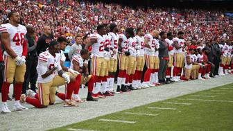 Oct 15, 2017; Landover, MD, USA; Multiple San Francisco 49ers players take a knee during there national anthem prior to their game against the Washington Redskins at FedEx Field. Mandatory Credit: Geoff Burke-USA TODAY Sports