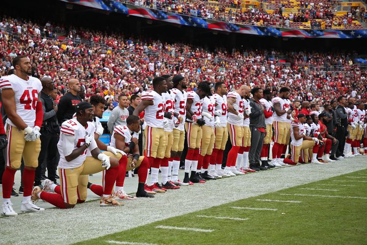 Six active members of the San Francisco 49ers and one inactive player took a knee during the national anthem as a gesture of
