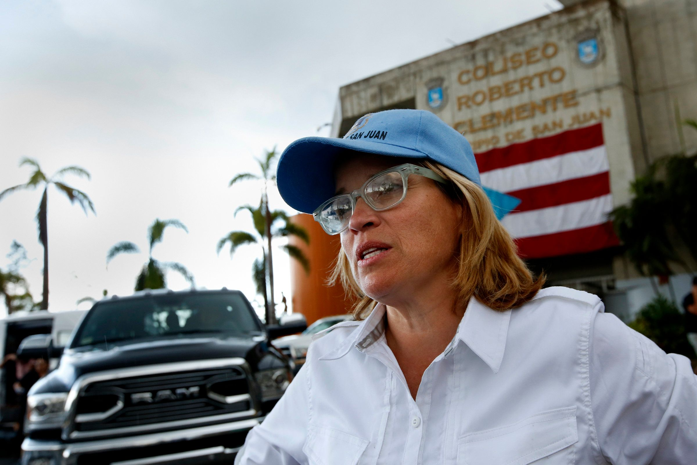 San Juan Mayor Carmen Yulín Cruz outside the Coliseo Roberto Clemente, a stadium that's been functioning as the c