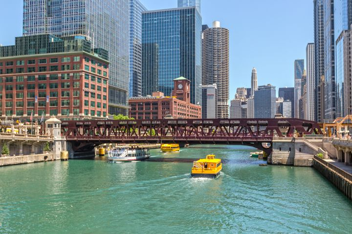 <p>Reid Murdoch Center clock tower visible from the Chicago River</p>