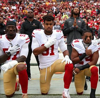 Members of the San Francisco 49ers protest racism and racial violence during playing of National Anthem.