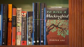 NEW ORLEANS, LA - MAY 28: A new printing of the book 'To Kill a Mockingbird,' by author Harper Lee, is on display at Faulkner House Books, on May 28, 2015 in New Orleans, Louisiana. Located in a tucked away alley off Jackson Square in the French Quarter, Faulkner Books is a New Orleans hidden gem. Faulkner Books is considered a national literary landmark and a historic location in the city. In 1925, the famous American novelist, William Faulkner, rented rooms in the same building where the bookstore is housed today. Faulkner Books sells new and used books, including classic and rare edition books by Faulkner and other historic writers. Collectors, authors, and visitors who have entered the cozy, literary sanctuary have described Faulkner Books as Americas most charming bookstore. (Photo by Melanie Stetson Freeman/The Christian Science Monitor via Getty Images)