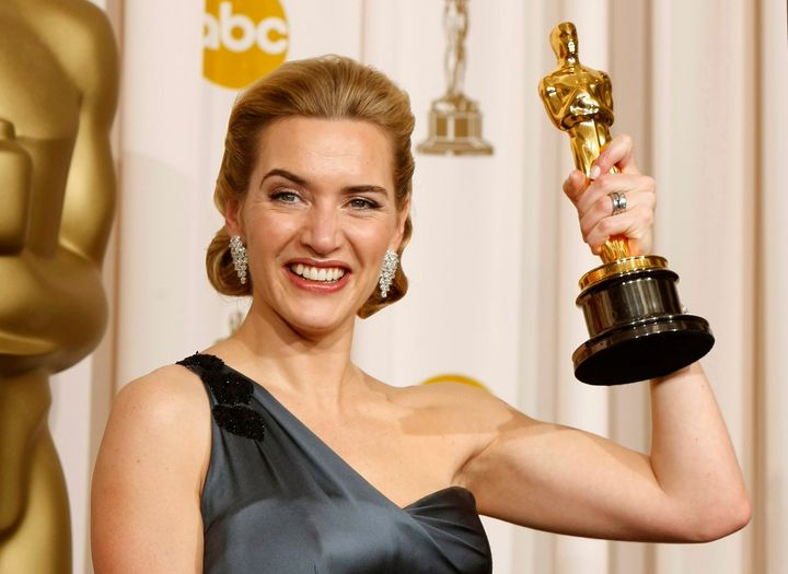 "Kate Winslet poses with her Oscar for her role in ""The Reader."""