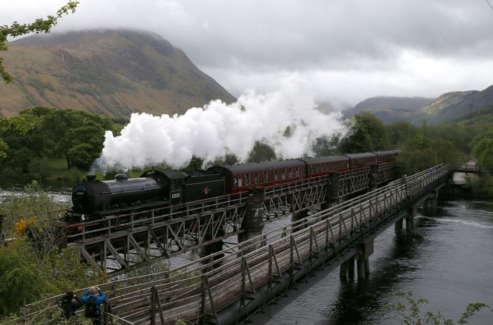 The Jacobite steam train crosses the river Lochy as it departs Fort William, Scotland. The train was used to depict the Hogwa