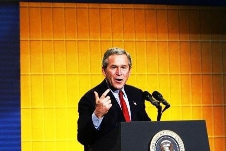 President George W. Bush speaks to corporate executives, economists, and academics during the closing of the two-day White Ho