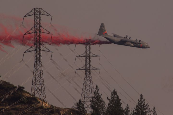 A National Guard air tanker drops fire retardant during the Oakmont Fire on October 15, 2017 near Santa Rosa, California. (Ph