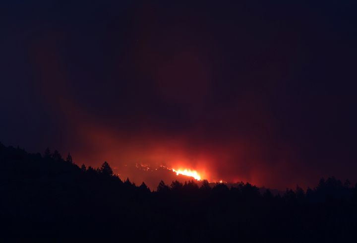 A wildfire burns in mountains above Sonoma, California, U.S., October 14, 2017. (REUTERS/Jim Urquhart)