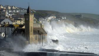 Waves break around the church in the harbour at Porthleven, Cornwall, as Hurricane Ophelia hits the UK and Ireland with gusts of up to 80mph. (Photo by Ben Birchall/PA Images via Getty Images)