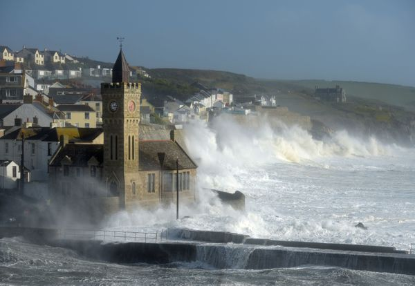 Waves break around the church in the harbour at Porthleven, Cornwall, as Hurricane Ophelia hits the UK and Ireland with gusts