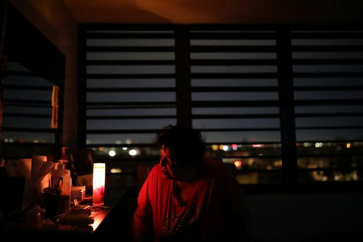 Carmen Correa uses a candle to light up a room at the Moradas Las Teresas Elderly House, where about two hundred elderly peop