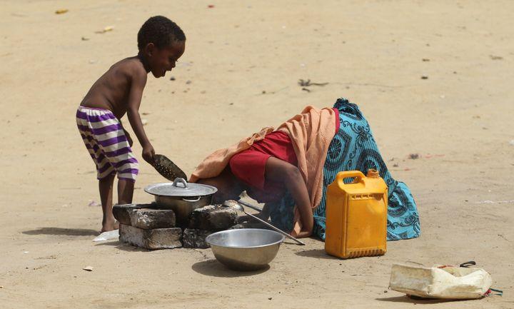 A child helps his mother light a fire inN'djamena, Chad.