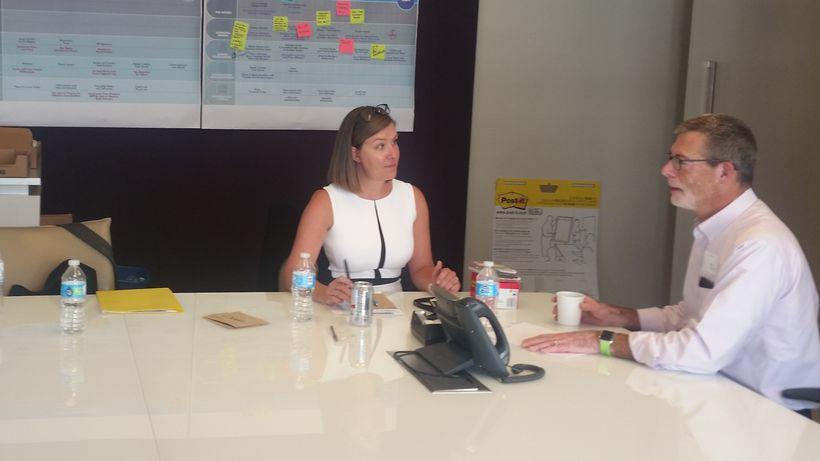 Washington D.C. Participant Bob Fox (FOX Architects) discusses ideas with Suzanne Maynard (CCG).