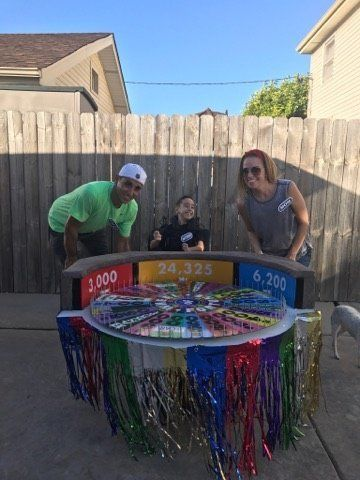"""Anthony Alfano and his parents with his """"Wheel Of Fortune"""" costume."""