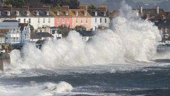 PENZANCE, UNITED KINGDOM - OCTOBER 16:  Waves whipped up by Hurricane Ophelia crash over the seafront in Penzance on October 16, 2017 in Cornwall, England. Hurricane Ophelia comes exactly 30 years after the Great Storm of 1987. Two people have been killed as the remnants of the storm hit the United Kingdom and Ireland.  (Photo by Matt Cardy/Getty Images)