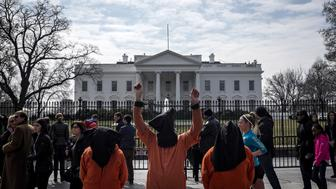 Protesters dressed as Guantanamo Bay prisoners take part in an anti-war demonstration to mark the 12th anniversary of the U.S. invasion of Iraq, in front of the White House in Washington March 21, 2015. REUTERS/James Lawler Duggan