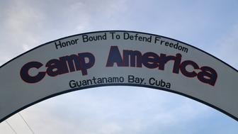 GUANTANAMO BAY, CUBA - OCTOBER 22: (EDITORS NOTE: Image has been reviewed by the U.S. Military prior to transmission.)   A sign hangs in a U.S. military guard camp at the U.S. prison at Guantanamo Bay, also known as 'Gitmo' on October 22, 2016 at the U.S. Naval Station at Guantanamo Bay, Cuba. The U.S. military's Joint Task Force Guantanamo is still holding 60 detainees at the prison, down from a previous total of 780. In 2008 President Obama issued an executive order to close the prison, which has failed because of political opposition in the U.S.  (Photo by John Moore/Getty Images)