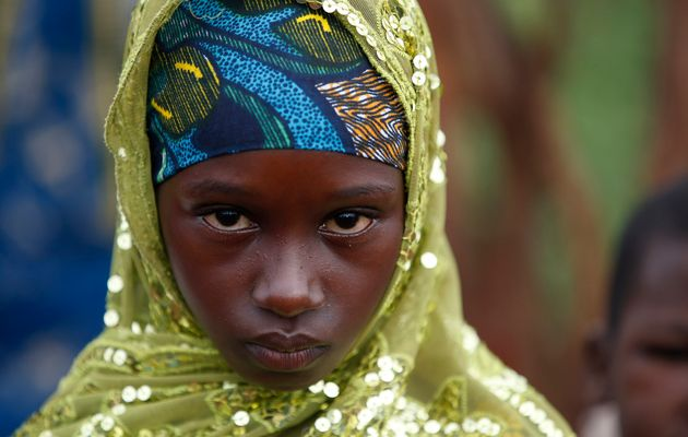 A girl from the Peul tribe stands in a village outside Bambari, Central African Republic.