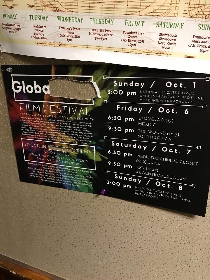 A defiled sign promoting the GlobaLGBTQ Film Festival at the University of Notre Dame