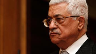 Palestinian Authority President Mahmoud Abbas during a press conference with Gordon Brown, held at 10 Downing Street, London.