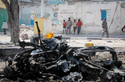 "Wreckage of Suicide Car Bomb in Mogadishu. ""<em>Poverty and not Religion is one of the main reasons that compels anyone to jo"