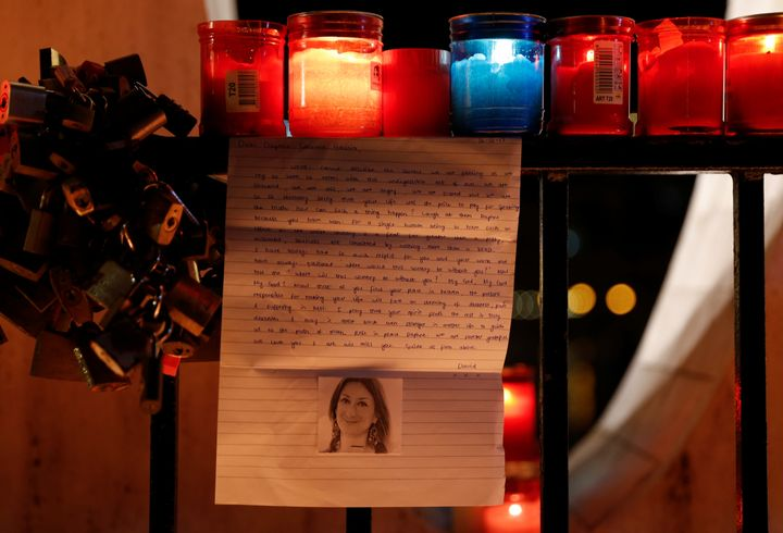 A tribute to Caruana Galizia at the Love monument during a candlelit vigil in St Julian's, Malta
