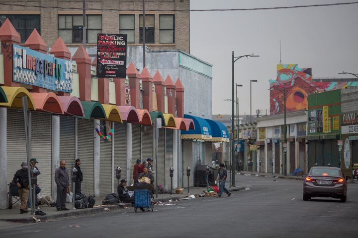 Homeless people on a Skid Row sidewalk in Los Angeles, California. The 2017 Greater Los Angeles Homeless Count indicates a 20