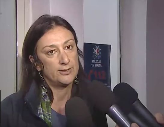 Caruana Galizia addresses the media in 2013 following her arrest over an article she published on her blog
