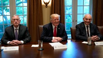 U.S. President Donald Trump (C) smiles between Defense Secretary James Mattis (L) and White House Chief of Staff John Kelly during a briefing with senior military leaders at the White House in Washington, U.S., October 5, 2017. REUTERS/Yuri Gripas