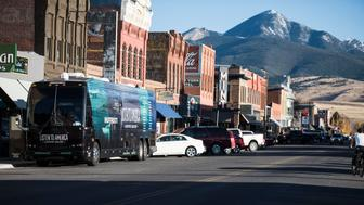 "LIVINGSTON, MT - OCTOBER 16: The tour bus sits in front of the city skyline during HuffPost's visit to Livingston, Montana, on Oct. 16, 2017, as part of ""Listen To America: A HuffPost Road Trip."" The outlet will visit more than 20 cities on its tour across the country. (Photo by Damon Dahlen/HuffPost) *** Local Caption ***"