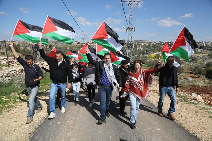 Palestinians stage a protest against Israel's separation wall.