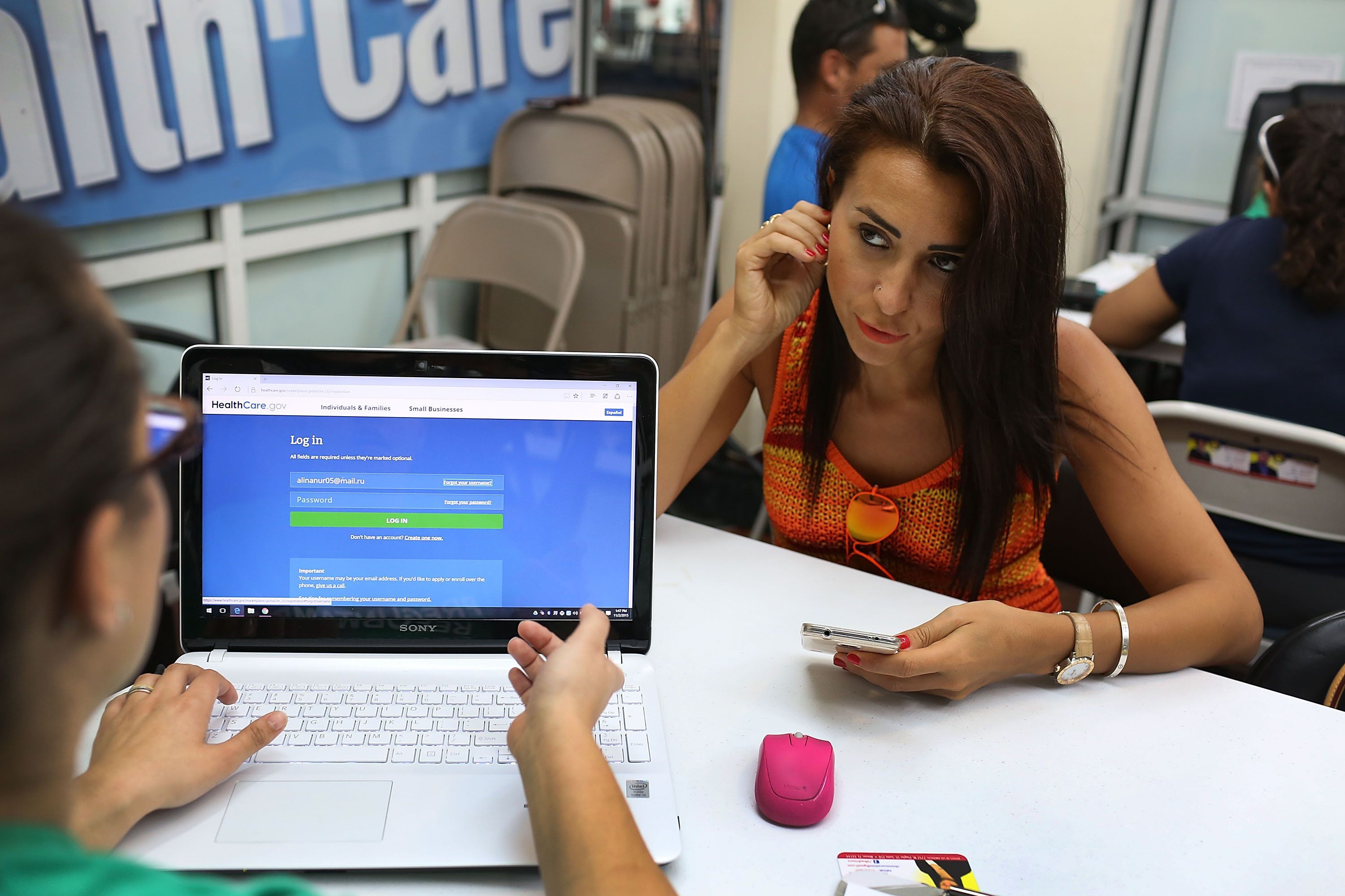 MIAMI, FL - NOVEMBER 02: Alina Nurieva (R)  sits with Gabriela Cisneros, an insurance agent from Sunshine Life and Health Advisors, as she picks an insurance plan available in the third year of the Affordable Care Act at a store setup in the Mall of the Americas on November 2, 2015 in Miami, Florida. Open Enrollment began yesterday for people to sign up for a 2016 insurance plan through the Affordable Care Act.  (Photo by Joe Raedle/Getty Images)