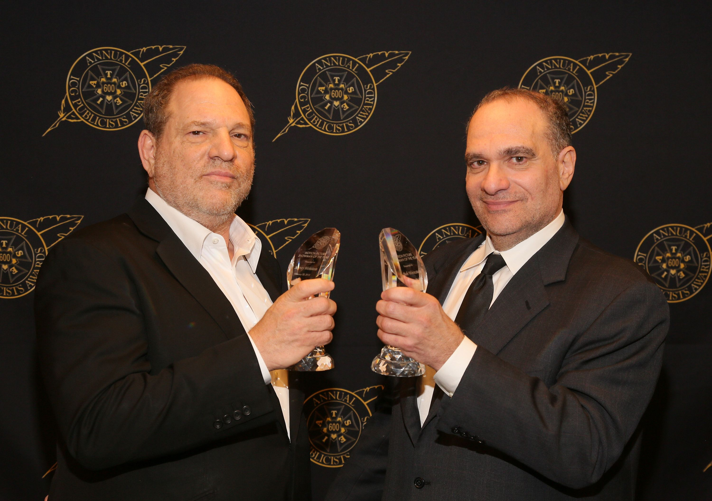 Harvey and Bob Weinstein pose with the Motion Picture Showmanship Award backstage at The Beverly Hilton hotel on Feb. 20, 201