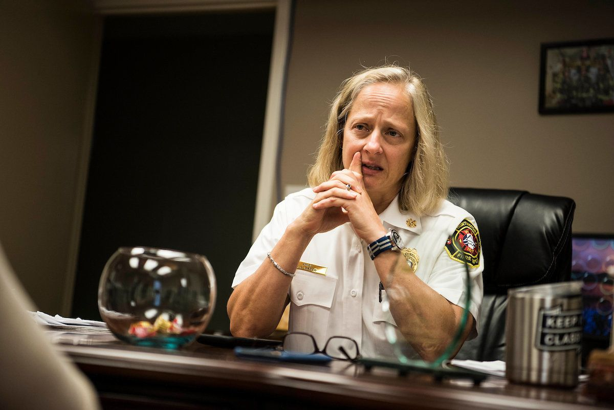 Fire Chief Jan Rader speaks to reporters about the opioid epidemic in her community while sitting in her office in Huntington, West Virginia.