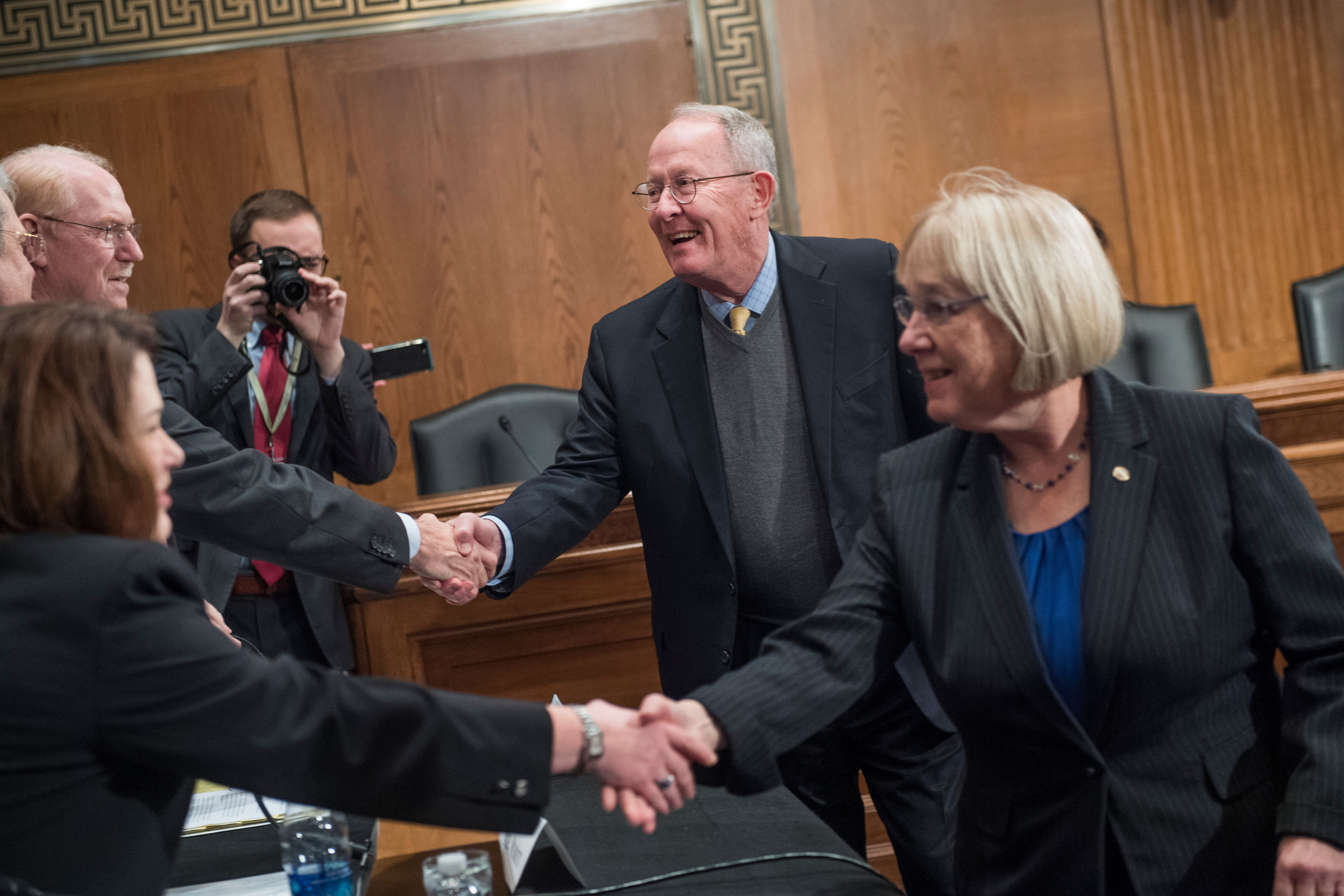 UNITED STATES - OCTOBER 17: Sen. Patty Murray, D-Wash., ranking member, and Chairman Lamar Alexander, R-Tenn., greet witnesses during a Senate Health, Education, Labor and Pensions Committee hearing in Dirksen Building titled 'The Cost of Prescription Drugs: How the Drug Delivery System Affects What Patients Pay, Part II,' on October 17, 2017. (Photo By Tom Williams/CQ Roll Call)