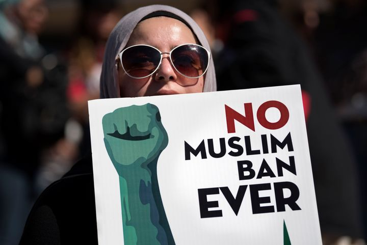 An activist in Los Angeles holds a sign on Oct. 15 during a protest against President Donald Trump's travel ban.