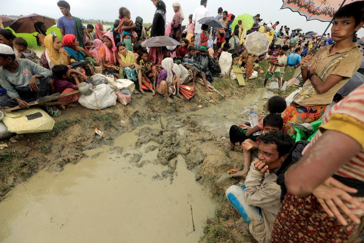 Rohingya refugees who fled from Myanmar wait to be let intoBangladesh on Oct. 16.