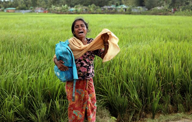 Taslima, a 20-year-old Rohingya refugee, cries on Oct. 16 after her father died while crossing the Myanmar-Bangladesh