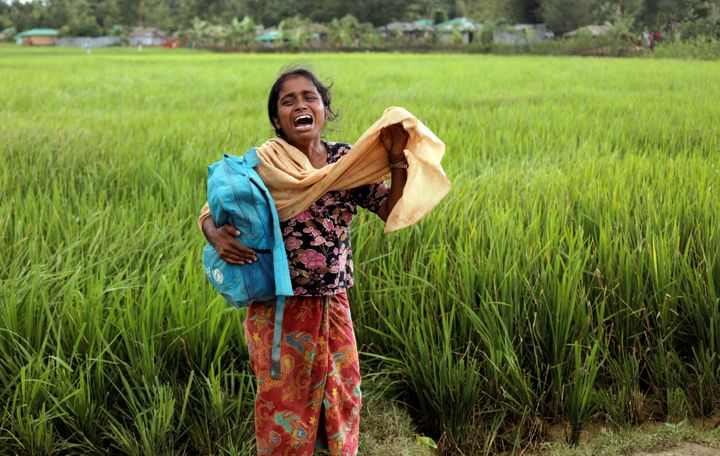 Taslima, a 20-year-old Rohingya refugee, cries on Oct. 16 after her father died while crossing the Myanmar-Bangladesh border.