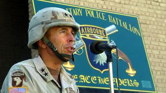 BABYLON, IRAQ - NOVEMBER 2:  In this handout photo from the U.S. Army, Maj. Gen. David H. Petraeus, commander of the 101st Airborne Division (Air Assault), speaks during the 716th Military Police Battalion during a assumption of command ceremony November 2, 2003 in Babylon, Iraq. Lt. Col. Ashton L. Hayes took command of the battalion after former commander Lt. Col. Kim S. Orlando was killed Oct. 16 in Karbala, Iraq.  (Photo by Chris Jones/U.S. Army via Getty Images)