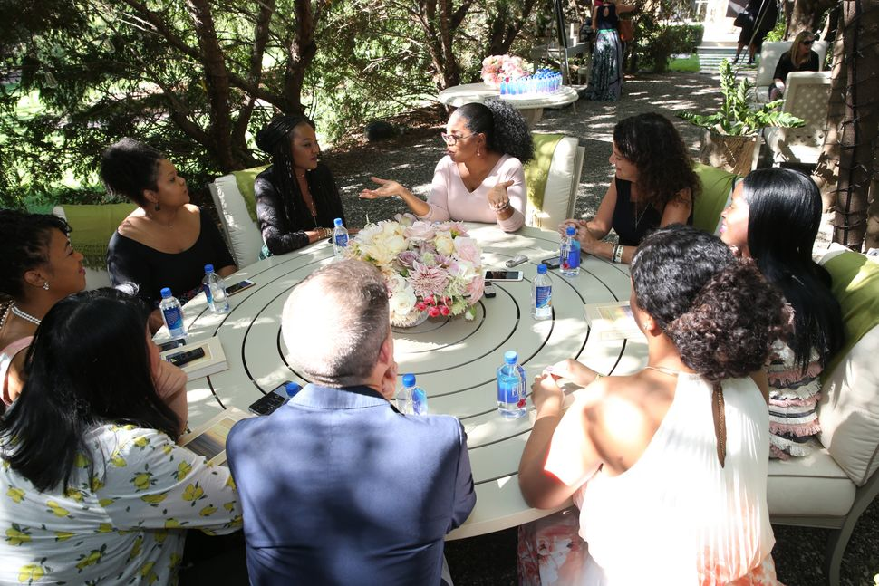 Oprah speaks to a roundtable of reporters during a special interview at her home in Santa Barbara, California. I'm pictured t