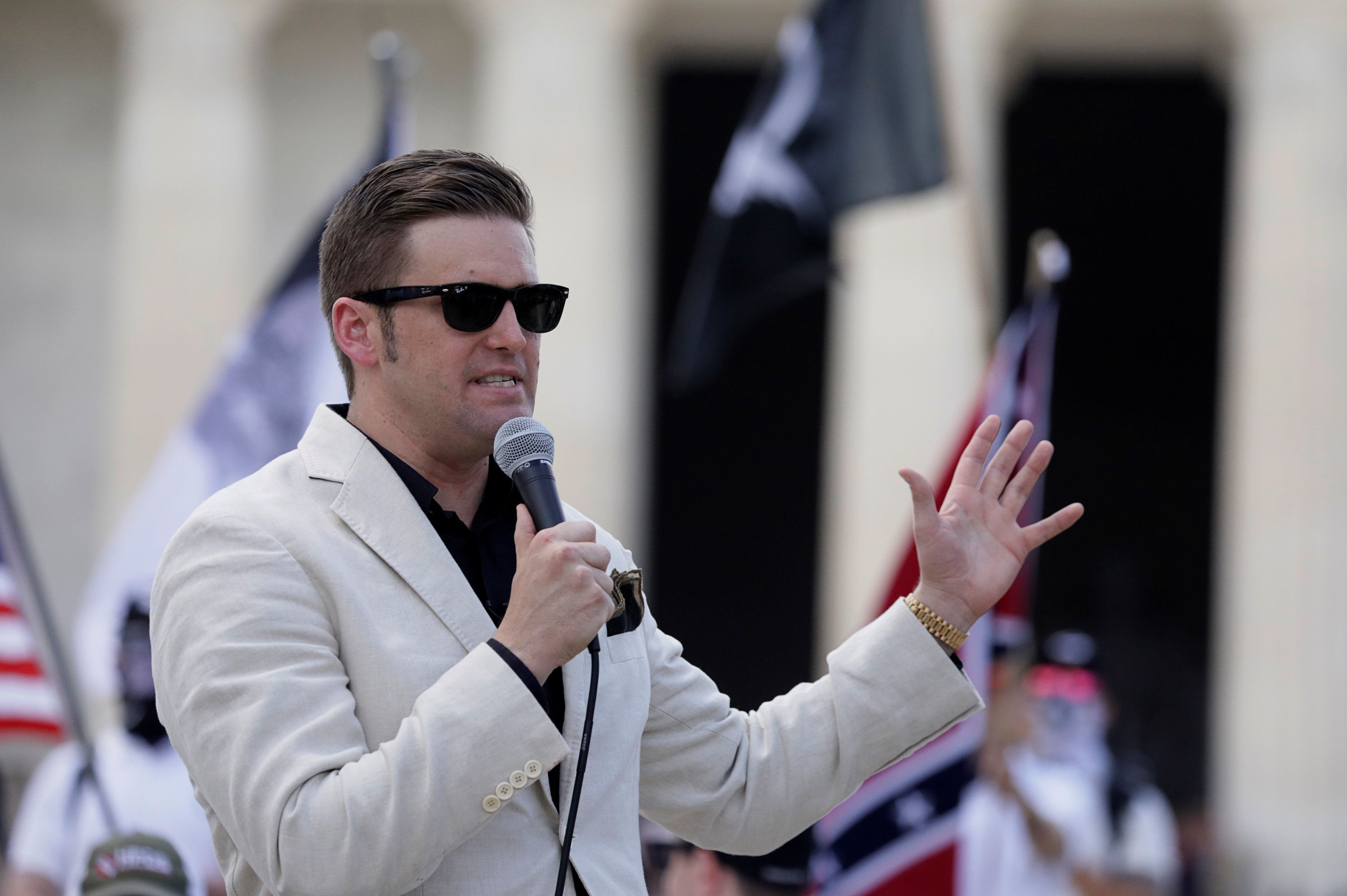 "White Nationalist and supremacist leader Richard Spencer addresses supporters as self proclaimed ""White Nationalists"" and ""Alt-Right"" activists gather for what they called a ""Freedom of Speech"" rally at the Lincoln Memorial (Rear)in Washington, U.S. June 25, 2017. REUTERS/Jim Bourg"