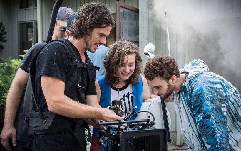 Music video director JohnPaul Morris (left) gives Katie Larson (center) and Michael Dause a sneak preview.